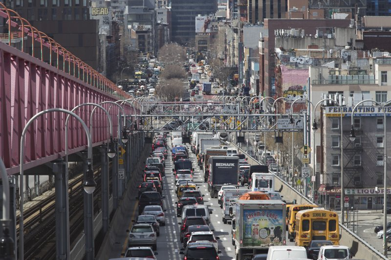 In this March 28, 2019 photo, traffic makes its way into Manhattan from Brooklyn over the Williamsburg Bridge in New York. (AP Photo/Mary Altaffer)