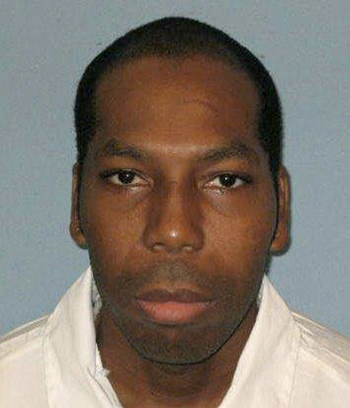 FILE - This undated file photo from the Alabama Department of Corrections shows inmate Dominique Ray. Texas death row inmate Patrick Murphy and Alabama death row inmate Dominique Ray both came to the Supreme Court recently with the same request. Halt my execution, each said, because the state won't let my spiritual adviser accompany me into the execution chamber, even as other inmates of different faiths get that ability. But while the Supreme Court declined to stop Ray's execution in February, they gave Murphy a temporary reprieve Thursday night. The difference in the two cases looks like it comes down to when each man asked for his spiritual adviser to be present. Alabama Department of Corrections via AP, File)