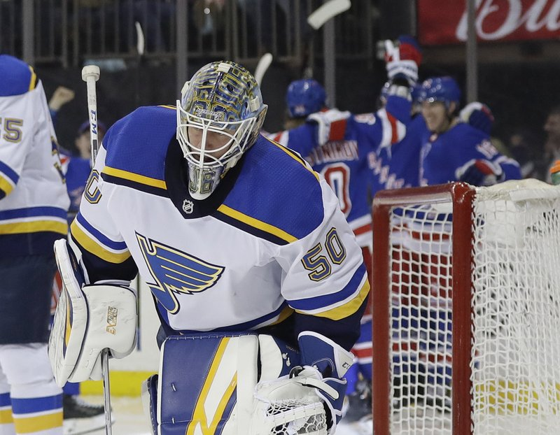 St. Louis Blues goaltender Jordan Binnington (50) skates away from New York Rangers players after Ryan Strome scored a goal during the second period of an NHL hockey game Friday, March 29, 2019, in New York. (AP Photo/Frank Franklin II)