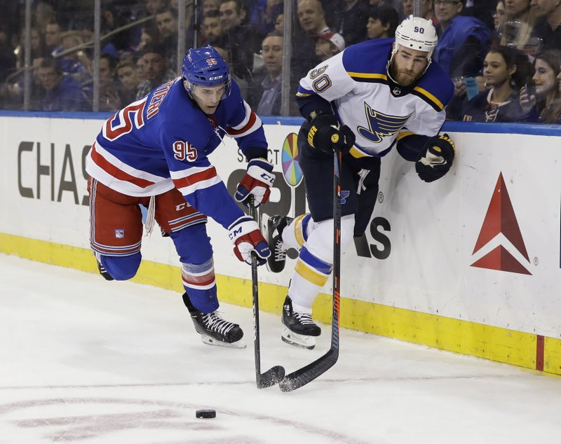 New York Rangers' Vinni Lettieri (95) fights for control of the puck with St. Louis Blues' Ryan O'Reilly (90) during the first period of an NHL hockey game Friday, March 29, 2019, in New York. (AP Photo/Frank Franklin II)