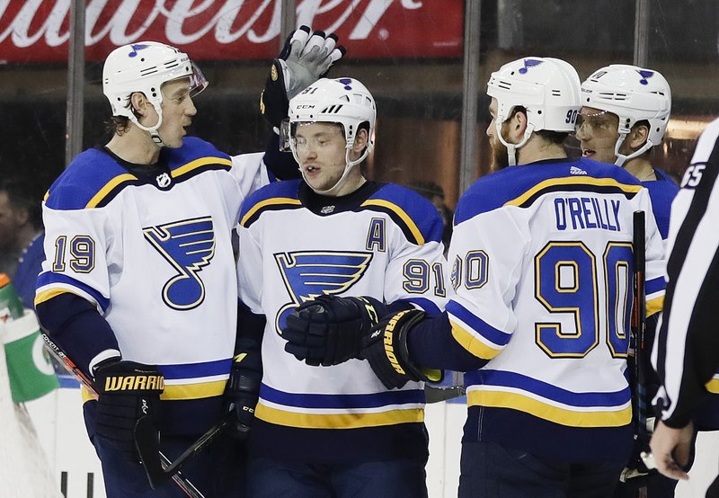 St. Louis Blues' Vladimir Tarasenko (91) celebrates with teammates Jay Bouwmeester (19) and Ryan O'Reilly (90) after scoring a goal during the first period of an NHL hockey game against the New York Rangers Friday, March 29, 2019, in New York. (AP Photo/Frank Franklin II)