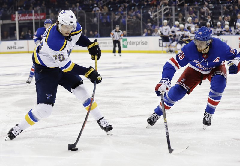 St. Louis Blues' Oskar Sundqvist (70) shoots the puck past New York Rangers' Marc Staal (18) during the first period of an NHL hockey game Friday, March 29, 2019, in New York. (AP Photo/Frank Franklin II)