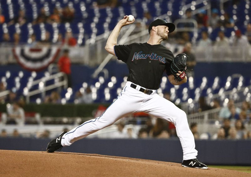 Miami Marlins starting pitcher Trevor Richards delivers during the first inning of a baseball game against the Colorado Rockies on Friday, March 29, 2019, in Miami. (AP Photo/Brynn Anderson)