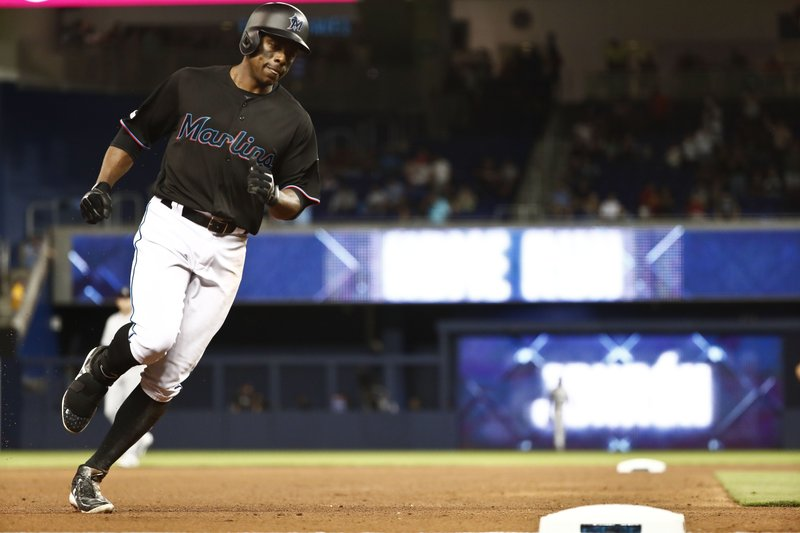 Miami Marlins' Curtis Granderson (21) heads to third base after hitting a solo home run during the fourth inning of a baseball game against the Colorado Rockies on Friday, March 29, 2019, in Miami. (AP Photo/Brynn Anderson)
