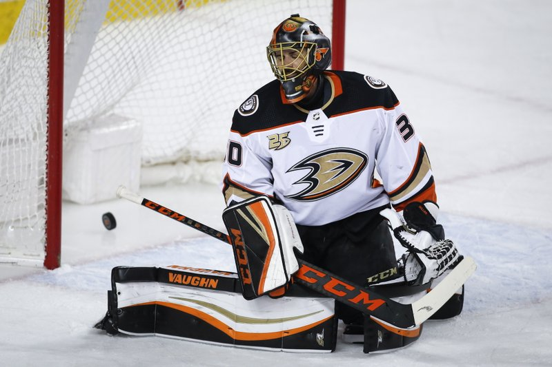 Anaheim Ducks goalie Ryan Miller reacts after letting in a goal to the Calgary Flames during the first period of an NHL hockey game Friday, March 29, 2019, in Calgary, Alberta. (Jeff McIntosh/The Canadian Press via AP)