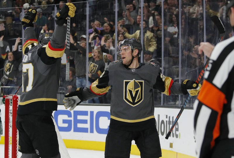 Vegas Golden Knights left wing Max Pacioretty, left, celebrates after center Paul Stastny, right, scored against the Minnesota Wild during the second period of an NHL hockey game Friday, March 29, 2019, in Las Vegas. (AP Photo/John Locher)