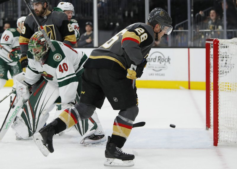 Vegas Golden Knights center Paul Stastny (26) scores against Minnesota Wild goaltender Devan Dubnyk (40) during the second period of an NHL hockey game Friday, March 29, 2019, in Las Vegas. (AP Photo/John Locher)