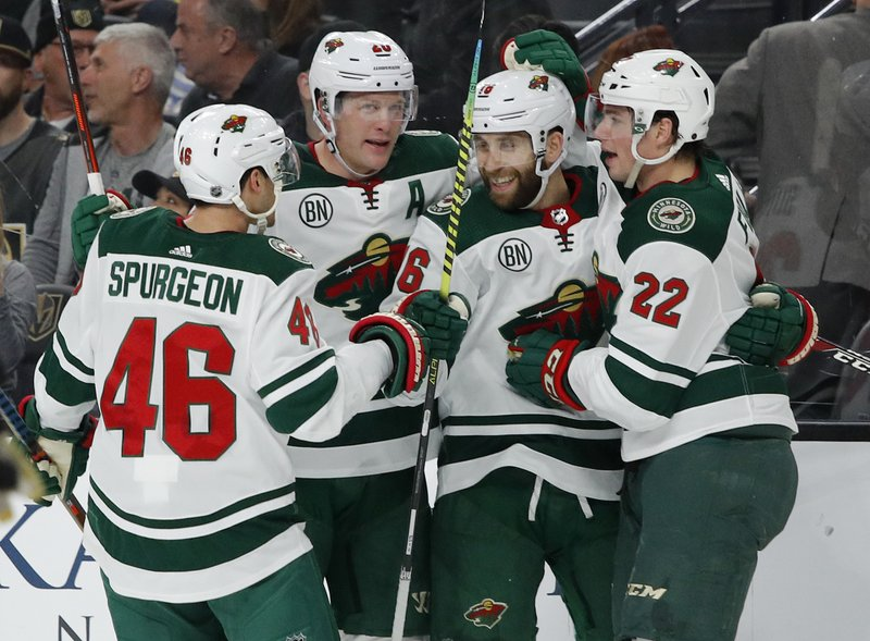 Minnesota Wild players celebrate after Jason Zucker, second from right, scored against the Vegas Golden Knights during the first period of an NHL hockey game Friday, March 29, 2019, in Las Vegas. (AP Photo/John Locher)