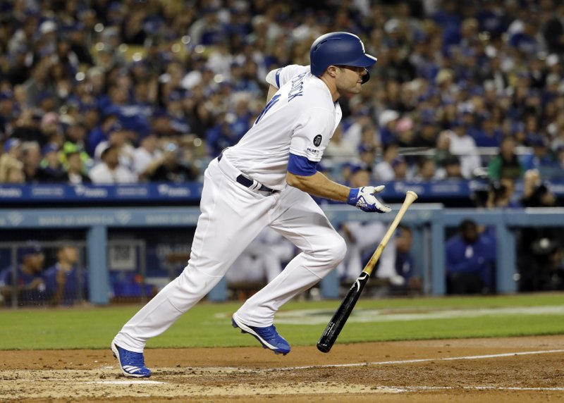 Los Angeles Dodgers' A.J. Pollock follows through on a bases-loaded two-RBI single against the Arizona Diamondbacks during the third inning of a baseball game Friday, March 29, 2019, in Los Angeles. (AP Photo/Marcio Jose Sanchez)