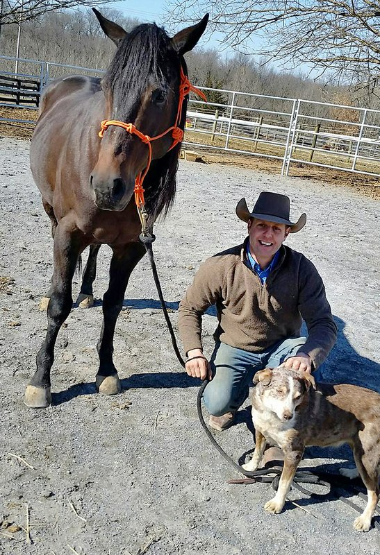 Pistol, a 6-year-old Texas heeler is pictured with RPM and Jeffrey Michael at Split Creek Equine Solutions in Hagerstown, Md. (Don Aines/The Herald-Mail via AP)