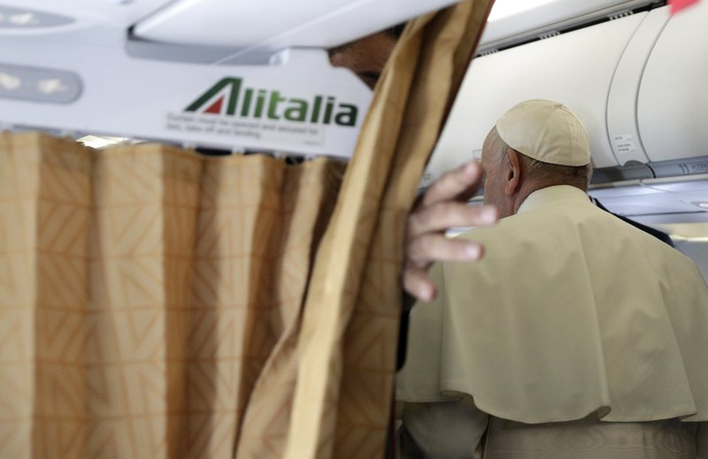 Pope Francis leaves after meeting journalists on board the flight from Rome to Rabat airport, Morocco, Saturday, March 30, 2019. (AP Photo/Gregorio Borgia, Pool)