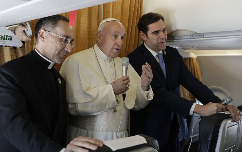 Pope Francis speaks to reporters during the flight from Rome to Rabat, Morocco, Saturday, March 30, 2019. (AP Photo/Gregorio Borgia)