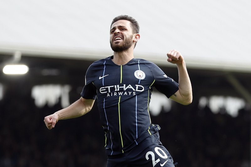 Manchester City's Bernardo Silva celebrates after scoring the opening goal during the English Premier League soccer match between Fulham and Manchester City at Craven Cottage stadium in London, Saturday, March 30, 2019. (AP Photo/Alastair Grant)
