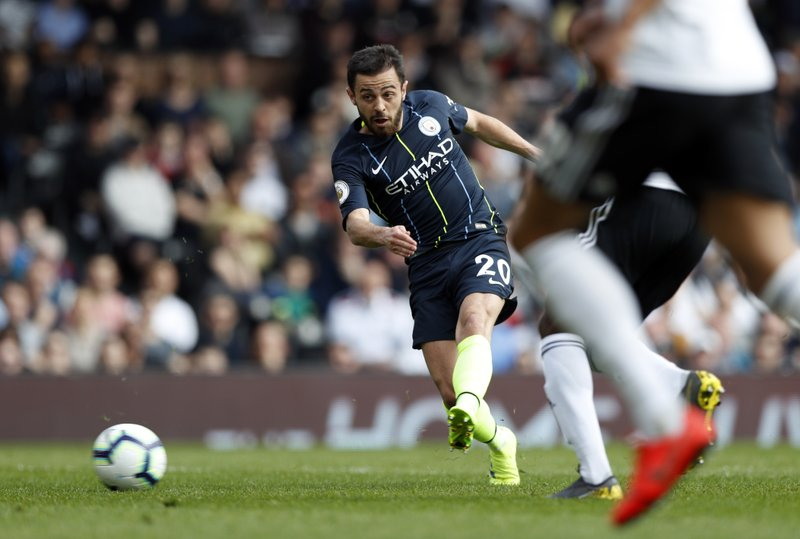 Manchester City's Bernardo Silva attempts a shot at goal during the English Premier League soccer match between Fulham and Manchester City at Craven Cottage stadium in London, Saturday, March 30, 2019. (AP Photo/Alastair Grant)