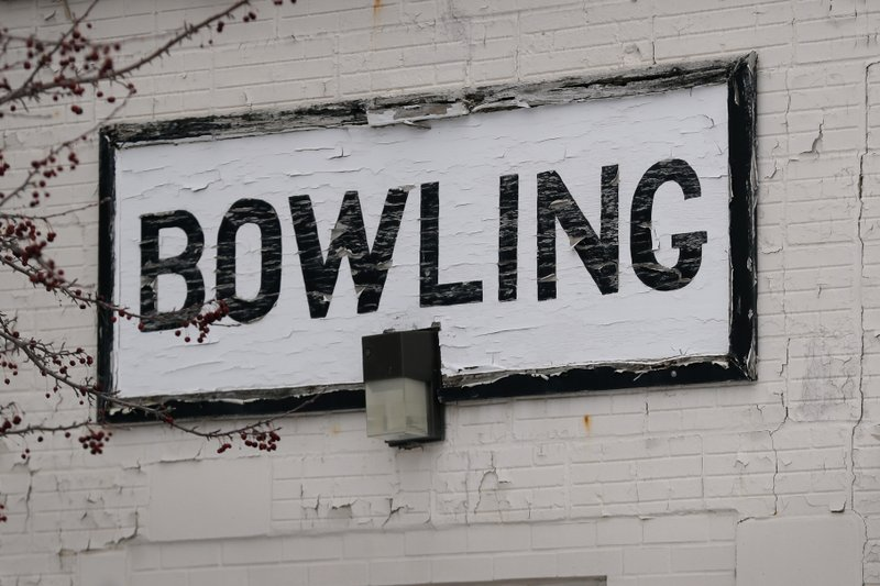 A sign hangs on the outside of the bowling alley on the Veterans Affairs campus, Tuesday, March 12, 2019, in Knoxville, Iowa. (AP Photo/Charlie Neibergall)