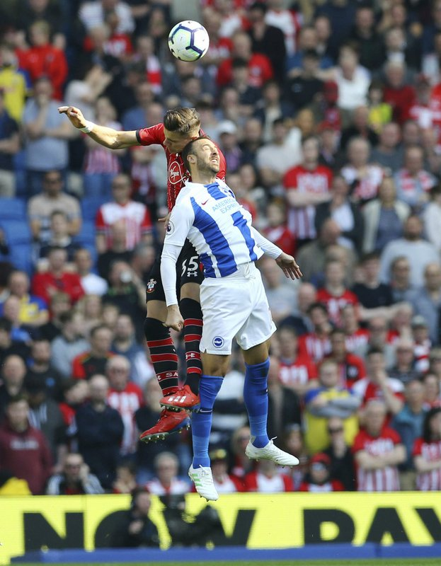 Southampton's Jan Bednarek, left, and Brighton & Hove Albion's Glenn Murray battle for the ball Brighton v Southampton during the English Premier League soccer match between Brighton and Hove Albion and Southampton at the Amex Stadium, Brighton England. (Gareth Fuller/PA via AP)