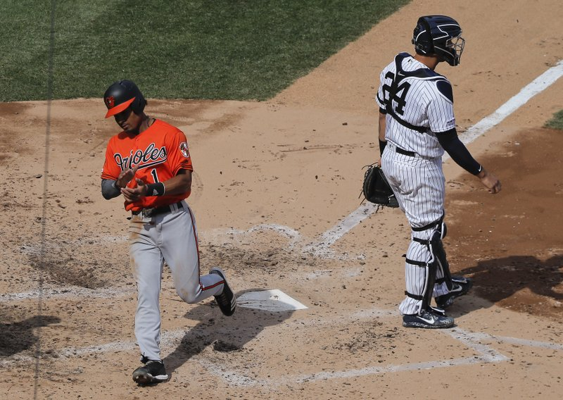 Baltimore Orioles' Richie Martin (1) reacts after scoring on a throwing error by New York Yankees catcher Gary Sanchez (24) during the sixth inning of a baseball game, Saturday, March 30, 2019, in New York. (AP Photo/Julie Jacobson)