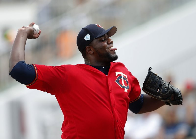 Minnesota Twins starting pitcher Michael Pineda (35) works in the first inning of a spring training baseball game against the Colorado Rockies Tuesday, March 26, 2019, in Fort Myers, Fla. (AP Photo/John Bazemore)