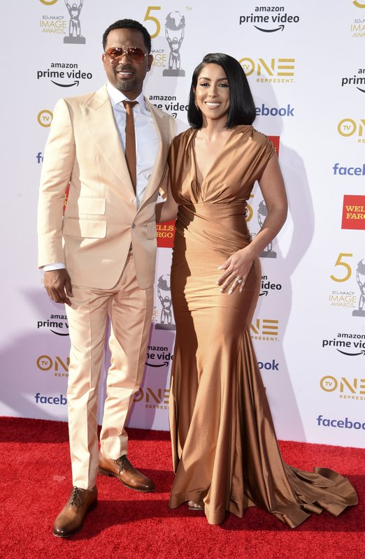Mike Epps, left, and Mechelle Epps arrive at the 50th annual NAACP Image Awards on Saturday, March 30, 2019, at the Dolby Theatre in Los Angeles. (Photo by Richard Shotwell/Invision/AP)