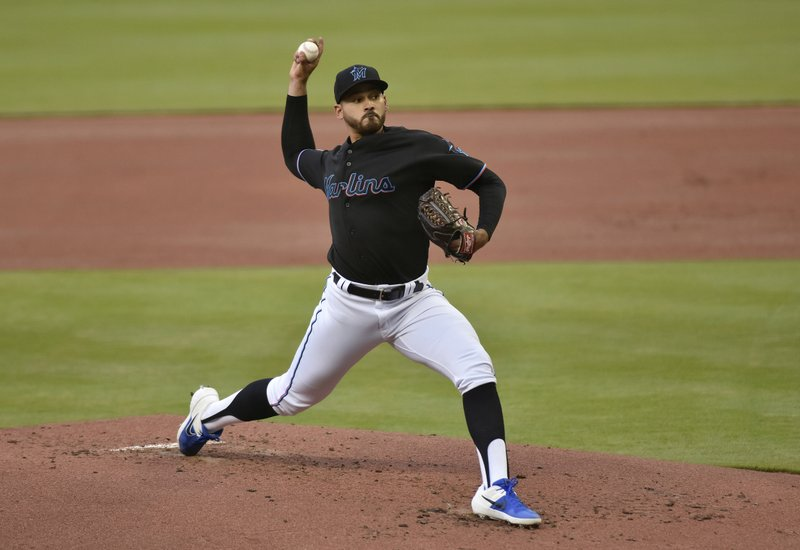 Marlins pitcher Pablo Lopez throws during the first inning of the team's baseball game against the Colorado Rockies in Miami on Saturday, March 30, 2019. (AP Photo/Gaston De Cardenas)
