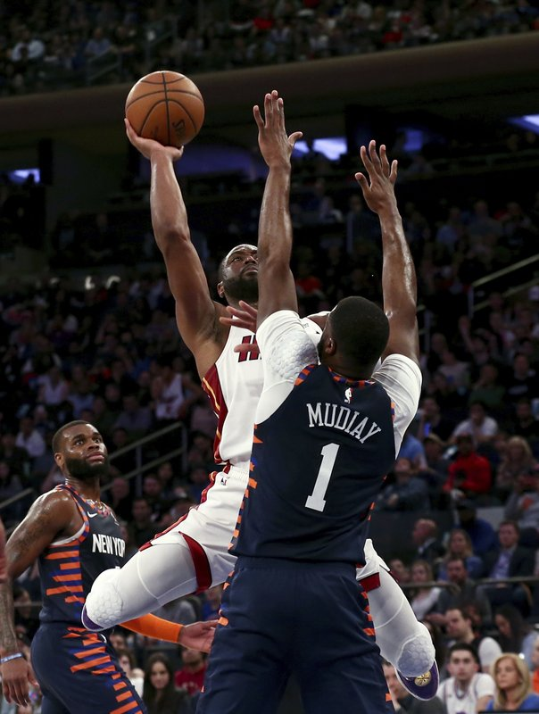 Miami Heat's Dwyane Wade shoots over New York Knicks' Emmanuel Mudiay during the first half of an NBA basketball game Saturday, March 30, 2019, in New York. (AP Photo/Nicole Sweet)