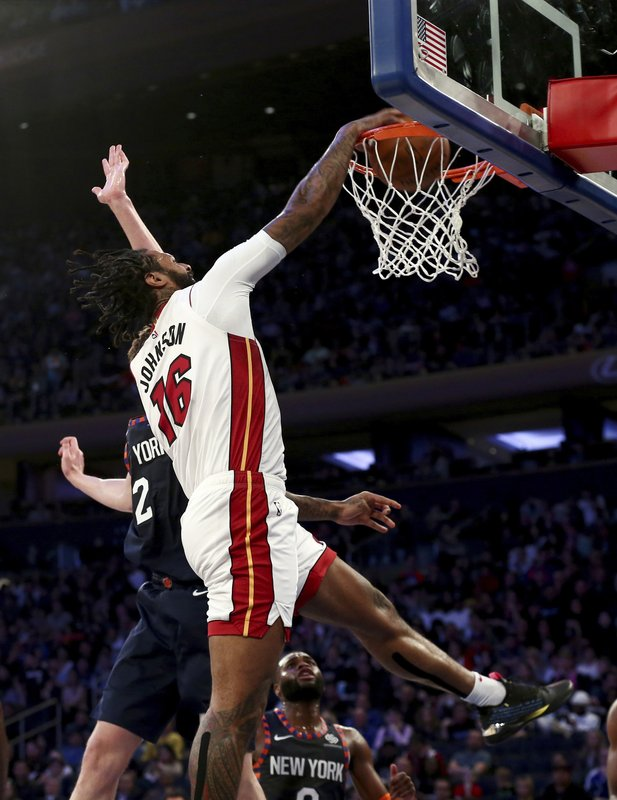 Miami Heat forward James Johnson (16) dunks against New York Knicks forward Luke Kornet (2) during the first half of an NBA basketball game Saturday, March 30, 2019, in New York. (AP Photo/Nicole Sweet)