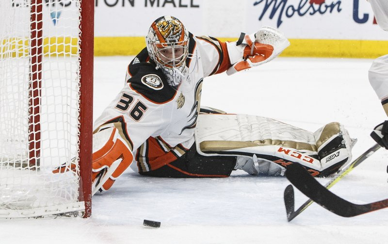 Anaheim Ducks' goalie John Gibson (36) makes a save against the Edmonton Oilers during the second period of an NHL hockey game Saturday, March 30, 2019, in Edmonton, Alberta. (Jason Franson/The Canadian Press via AP)