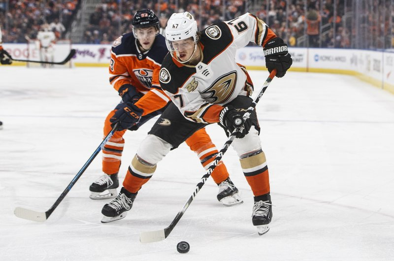 Anaheim Ducks' Rickard Rakell (67) is chased by Edmonton Oilers' Ryan Nugent-Hopkins (93) during the first period of an NHL hockey game Saturday, March 30, 2019, in Edmonton, Alberta. (Jason Franson/The Canadian Press via AP)