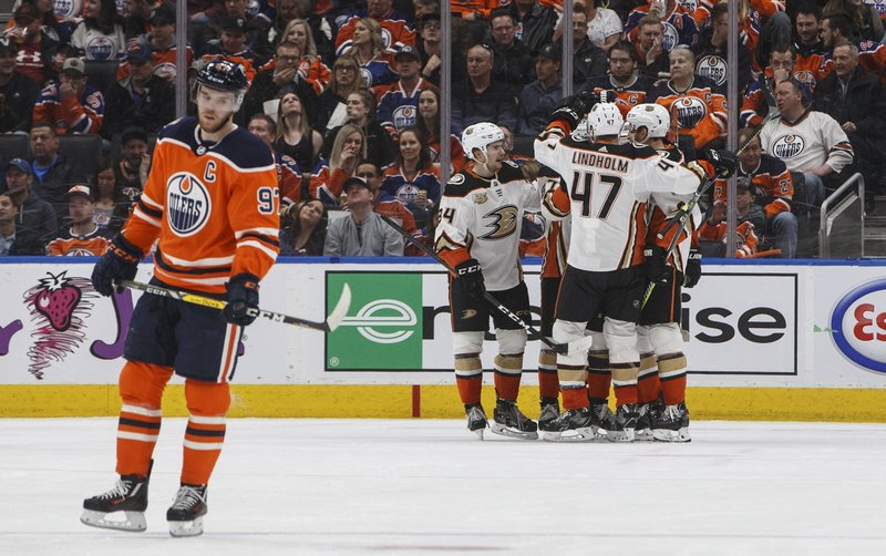 Anaheim Ducks celebrate a goal as Edmonton Oilers' Connor McDavid (97) skates to the bench during the second period of an NHL hockey game Saturday, March 30, 2019, in Edmonton, Alberta. (Jason Franson/The Canadian Press via AP)