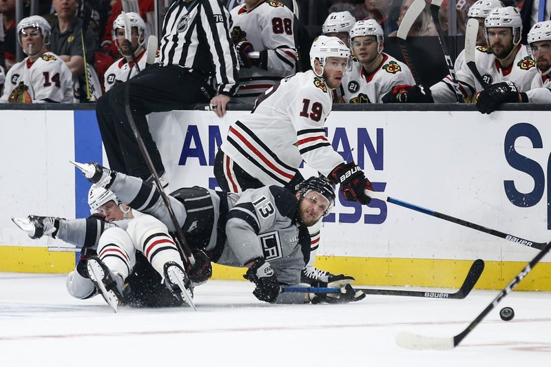Los Angeles Kings forward Kyle Clifford (13) collides with Chicago Blackhawks defenseman Connor Murphy, on ice at left, during the second period of an NHL hockey game Saturday, March 30, 2019, in Los Angeles. (AP Photo/Ringo H.W. Chiu)