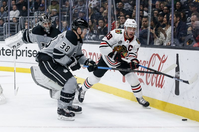 Los Angeles Kings goalie Jack Campbell (36) watches as forward Carl Grundstrom (38) and Chicago Blackhawks forward Jonathan Toews (19) compete for the puck during the first period of an NHL hockey game Saturday, March 30, 2019, in Los Angeles. (AP Photo/Ringo H.W. Chiu)