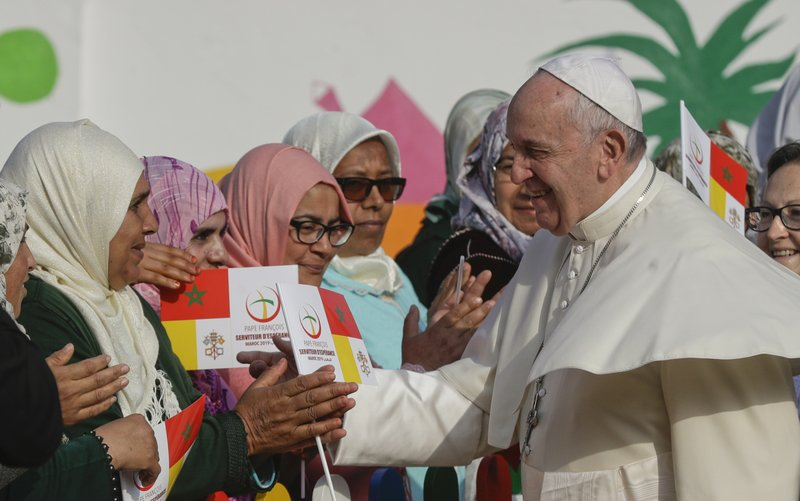 Pope Francis greets women upon his arrival to the Rural Center for Social Services at Temara, south of Rabat, Morocco, Sunday, March 31, 2019. (AP Photo/Gregorio Borgia)