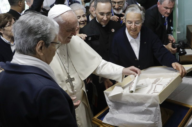 Pope Francis exchanges gifts during a visit to the Rural Center for Social Services at Temara, south of Rabat, Morocco, Sunday, March 31, 2019. (AP Photo/Gregorio Borgia)