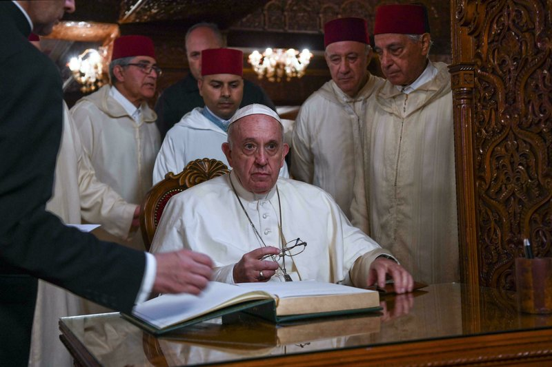 Pope Francis leaves a message in the guest book of the Mausoleum of Mohammed V in Rabat Saturday, March 30, 2019. (Ciro Fusco /ANSA via AP)