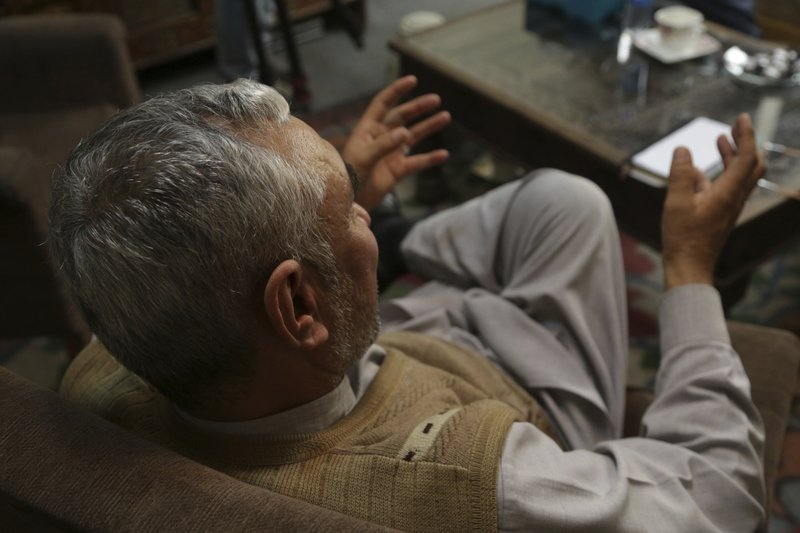 In this Feb. 17, 2019 photo, a village elder speaks during an interview with The Associated Press, in Kabul, Afghanistan. (AP Photo/Rahmat Gul)