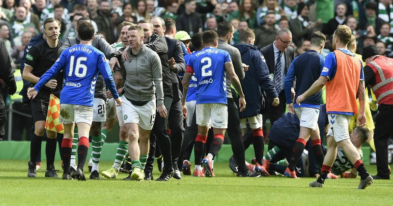 Rangers and Celtic players clash after final whistle during their Scottish Premiership soccer match at Celtic Park in Glasgow, Scotland, Sunday March 31, 2019. (Ian Rutherford/PA via AP)