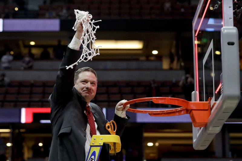 Texas Tech coach Chris Beard holds up the net after the team's win over Gonzaga in the West Regional final in the NCAA men's college basketball tournament Saturday, March 30, 2019, in Anaheim, Calif. (AP Photo/Marcio Jose Sanchez)