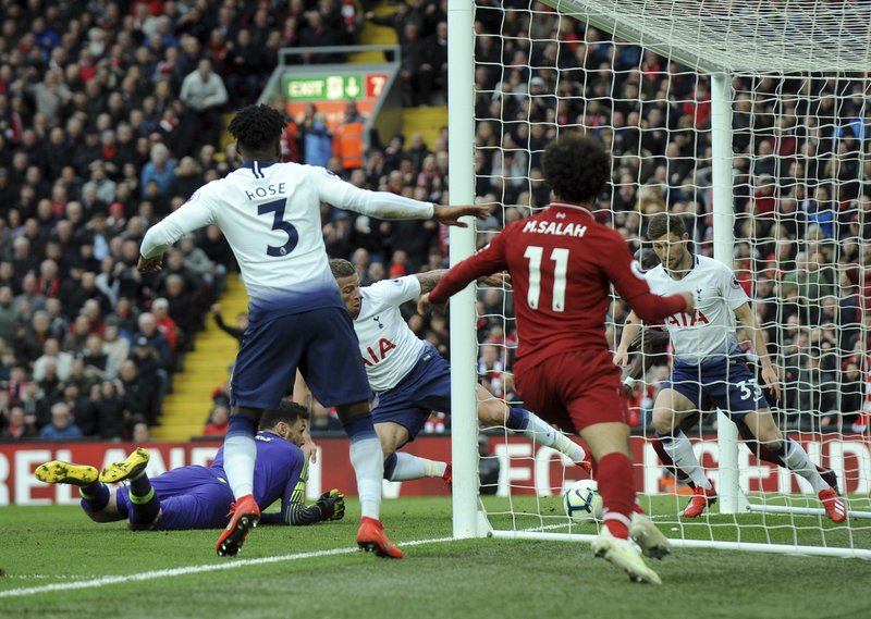 Tottenham's Toby Alderweireld, center, scores an own goal past his goalkeeper during the English Premier League soccer match between Liverpool and Tottenham Hotspur at Anfield stadium in Liverpool, England, Sunday, March 31, 2019. (AP Photo/Rui Vieira)