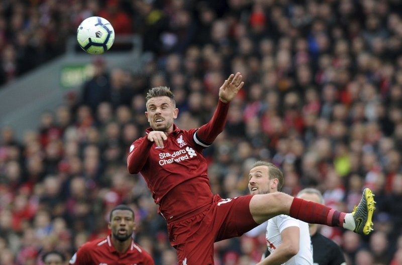 Liverpool's Jordan Henderson heads the ball during the English Premier League soccer match between Liverpool and Tottenham Hotspur at Anfield stadium in Liverpool, England, Sunday, March 31, 2019. (AP Photo/Rui Vieira)