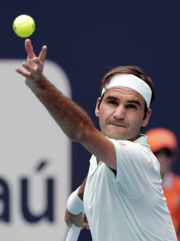 Roger Federer, of Switzerland, serves to John Isner during the singles final of the Miami Open tennis tournament, Sunday, March 31, 2019, in Miami Gardens, Fla. (AP Photo/Lynne Sladky)