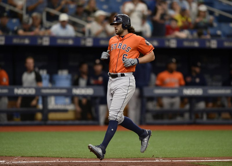 Houston Astros' Jake Marisnick (6) rounds the bases after his home run during the third inning of a baseball game against the Tampa Bay Rays, Sunday, March 31, 2019, in St. (AP Photo/Jason Behnken)
