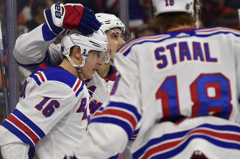 New York Rangers' Ryan Strome (16) is congratulated by teammates after scoring a goal during the first period of an NHL hockey game against the Philadelphia Flyers, Sunday, March 31, 2019, in Philadelphia. (AP Photo/Derik Hamilton)