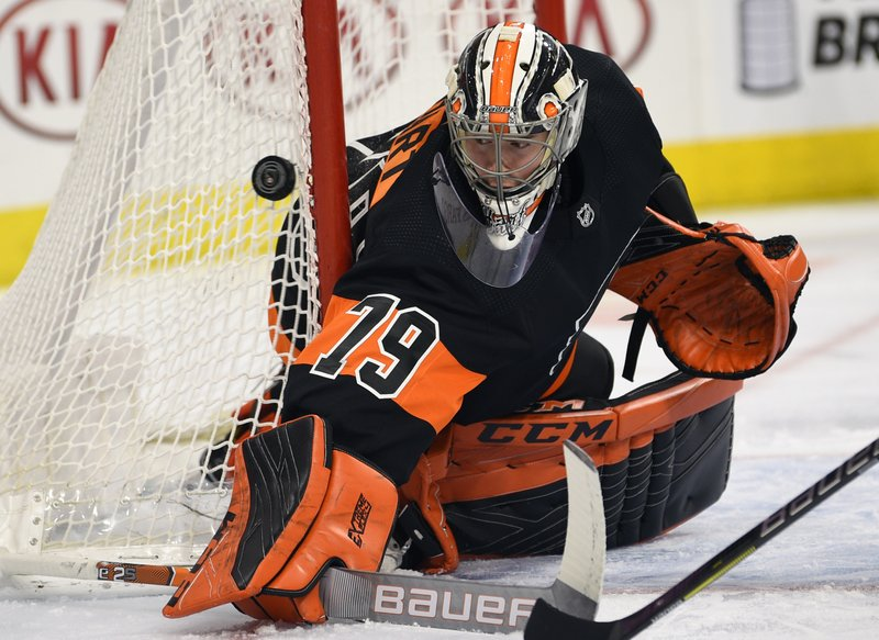 Philadelphia Flyers goaltender Carter Hart watches the puck after making a save during the first period of an NHL hockey game against the New York Rangers, Sunday, March 31, 2019, in Philadelphia. (AP Photo/Derik Hamilton)