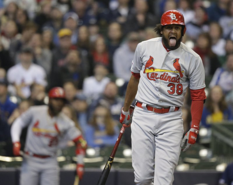 St. Louis Cardinals' Jose Martinez reacts after hitting a foul ball against the Milwaukee Brewers during the first inning of a baseball game Sunday, March 31, 2019, in Milwaukee. (AP Photo/Jeffrey Phelps)