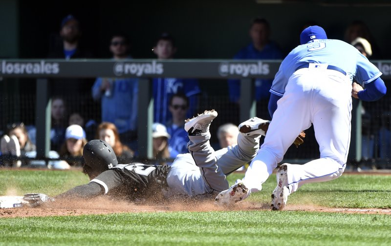 Chicago White Sox's Leury Garcia, left, is tagged out by Kansas City Royals first baseman Lucas Duda while diving into first in the seventh inning during a baseball game Sunday, March 31, 2019, in Kansas City, Mo. (AP Photo/Ed Zurga)