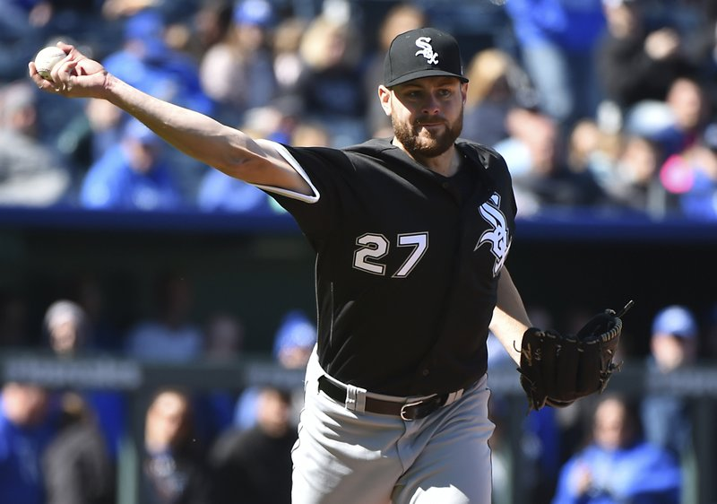 Chicago White Sox starting pitcher Lucas Giolito throws to first to get out Kansas City Royals' Adalberto Mondesi during a baseball game in the seventh inning Sunday, March 31, 2019, in Kansas City, Mo. (AP Photo/Ed Zurga)