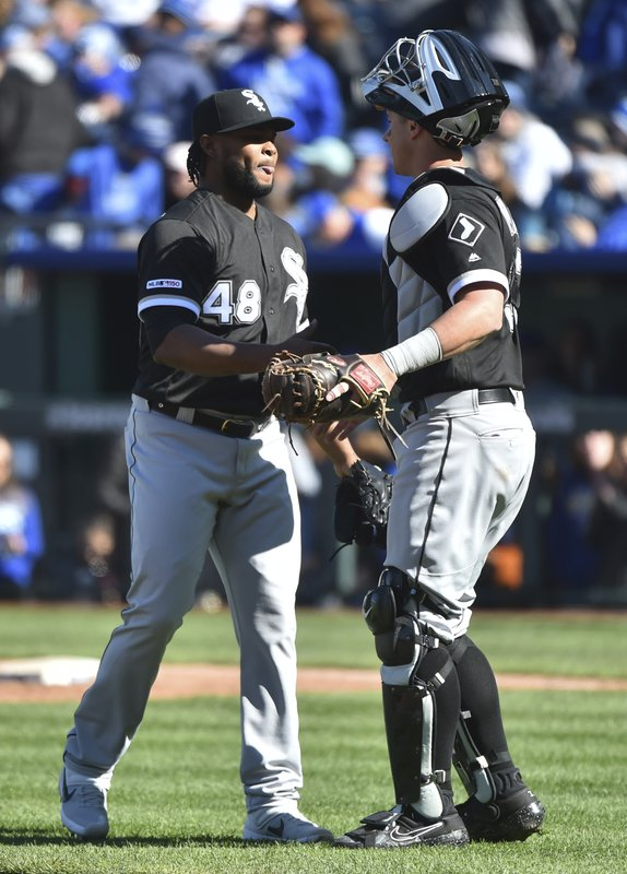 Chicago White Sox relief pitcher Alex Colome, left, and catcher James McCann celebrate their victory over the Kansas City Royals in a baseball game Sunday, March 31, 2019, in Kansas City, Mo. (AP Photo/Ed Zurga)