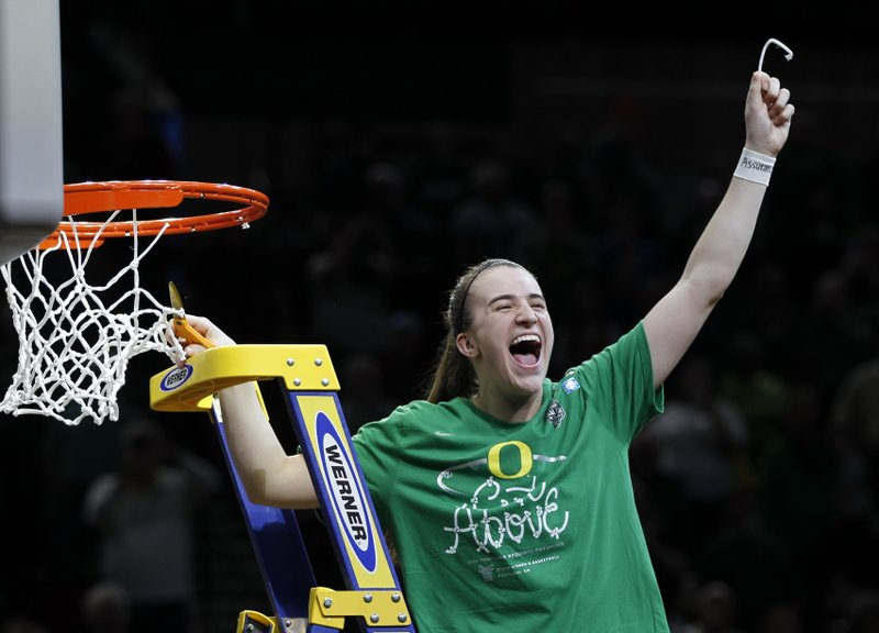 Oregon guard Sabrina Ionescu celebrates a regional final victory over Mississippi State in the NCAA women's college basketball tournament Sunday, March 31, 2019, in Portland, Ore. (AP Photo/Steve Dipaola)