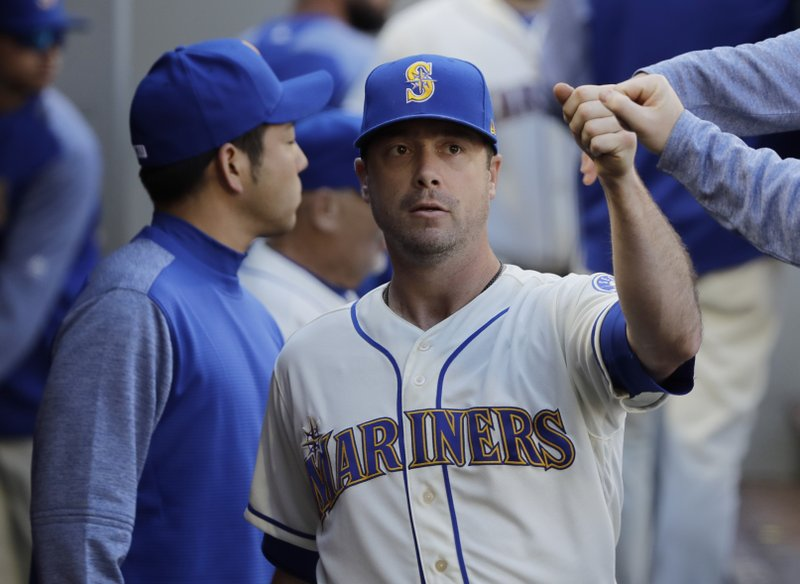 Seattle Mariners starting pitcher Wade LeBlanc is greeted in the dugout after he was pulled from a baseball game against the Boston Red Sox during the sixth inning, Sunday, March 31, 2019, in Seattle. (AP Photo/Ted S. Warren)