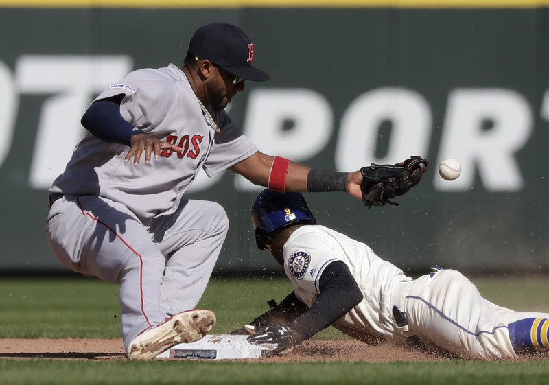 Seattle Mariners' Dee Gordon, right safely steals second base as the ball pops out of the glove of Boston Red Sox second baseman Eduardo Nunez during the seventh inning of a baseball game, Sunday, March 31, 2019, in Seattle. (AP Photo/Ted S. Warren)